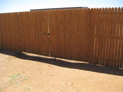 Fix gaps under fences to keep dog in and other creatures out.